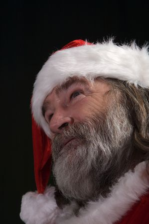 A young Santa with gray hair and beard having a good time Stock Photo