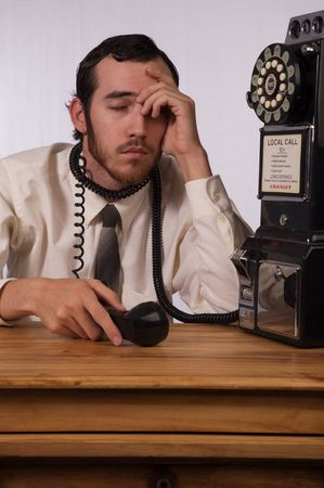 Young businessman dealing with too many phones Stock Photo - 2175987