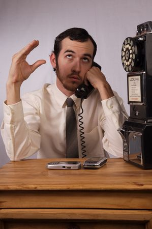 Young businessman dealing with too many phones Stock Photo - 2175988