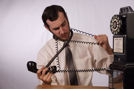 Young businessman dealing with too many phones Stock Photo - 2175982