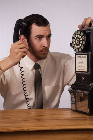 Young businessman dealing with too many phones Stock Photo - 2175984