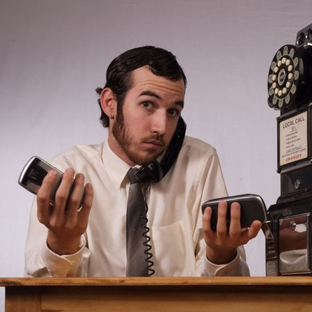 Young businessman dealing with too many phones Stock Photo - 2175990