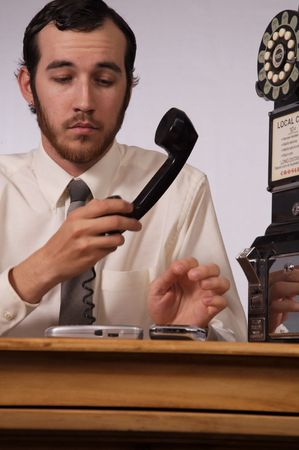 Young businessman dealing with too many phones Stock Photo - 2175983