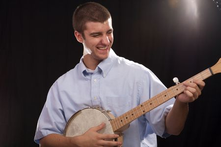 Young man having a good time playing the banjo