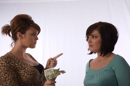 Two young women having an argument over money
