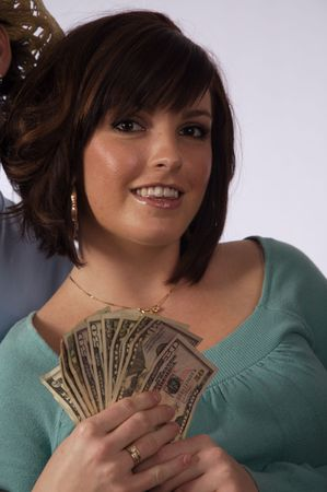 A young woman happy about having money Stock Photo