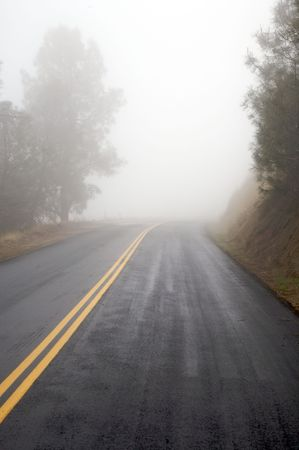 Wet, foggy road in the mountains.