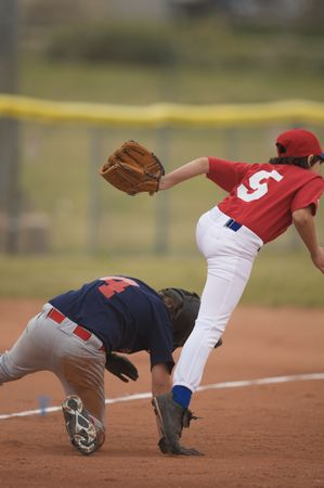 Two baseball players in a tight play