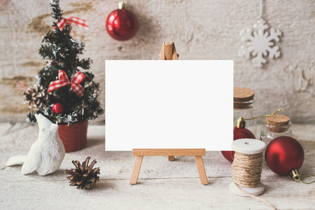 mockup: Stylish branding mockup to display your artworks. Cute vintage christmas new year gifts mock up on wooden background.