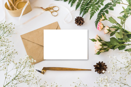 Stylish brending mockup with flowers to display your artworks. Foto de archivo