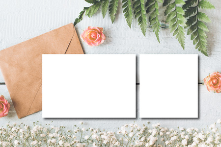 Stylish branding mockup to display your artworks. Cute vintage mock up on wooden background.