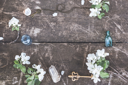 Stylish branding mockup with flowers, jars and crystalls to display your artworks. Cute vintage mock up on wooden background. Foto de archivo