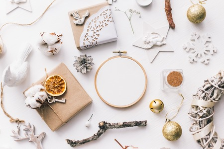 Flat lay top view Christmas photo with an embroidery hoop and cute decoration.