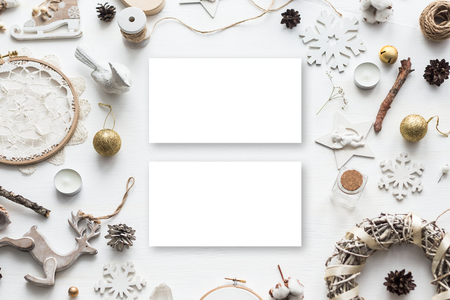 Stylish branding mockup to display your artworks. Cute vintage christmas new year gifts mock up on wooden background. Flat lay top view.