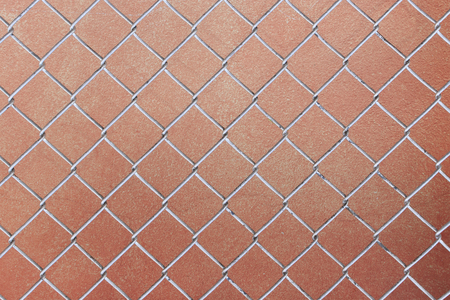 chain fence with old red brick wall background