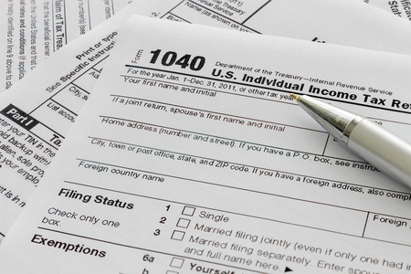 US tax form, over light [blur and select focus background]