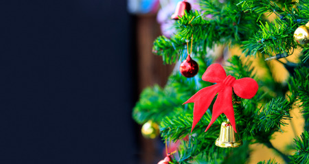 christmas tree with soft-focus and overlight in the background Banco de Imagens