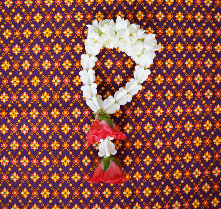 malai: Jasmine garland with red rose on Thai fabric, Thai name Malai