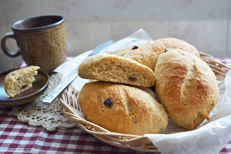 whole wheat: Home made whole wheat bread with raisins in the basket Stock Photo