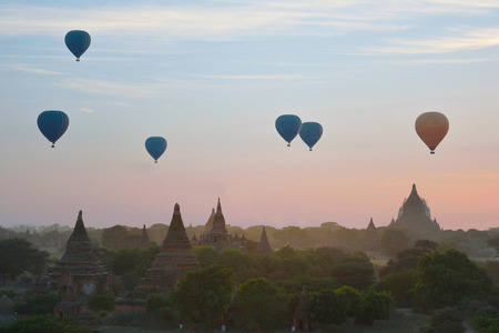 BAGAN, MYANMAR-JANUARY 19, 2017: Sunrise with hot air balloons are flying over the pagodas plain of Bagan, Myanmar.