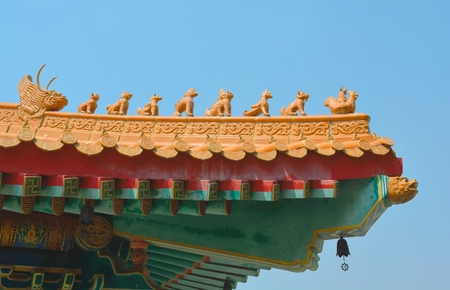 Ancient decoration statue on the roof in Chinese temple