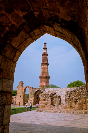 View of Qutab Minar, the tallest minaret in the world 73 metre tall tapering tower of five storeys made from sandstone bricks in the Mehrauli area of Delhi, India.