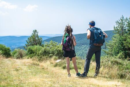 man and woman talk about their route in the mountain