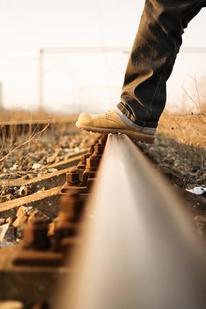 rail track: Man foot stepping on a rail track