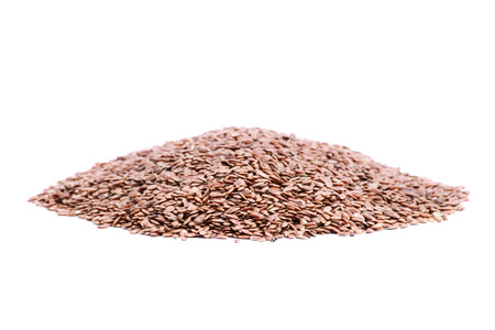 organic flax seed: Heap of flax seeds isolated on white background Stock Photo