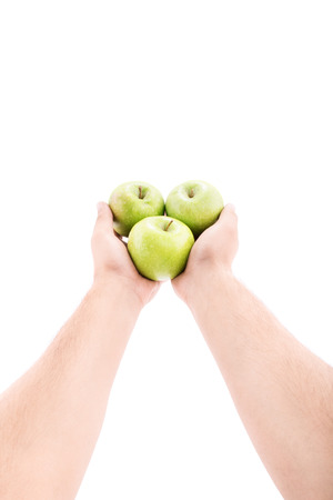 outwards: Male hands stretched outwards offering apples isolated on white background Stock Photo