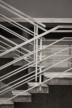 metallic stairs: Going up? Concrete stairs with metallic fence