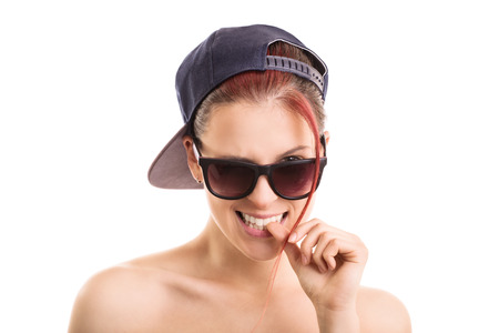 Oops, i think a made a mistake? Yong girl wearing sunglasses and a sports hat isolated on white background photo