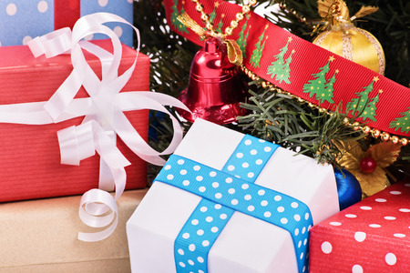 toygift: A close up shot of Christmas decorations, ornaments and a Christmas tree.