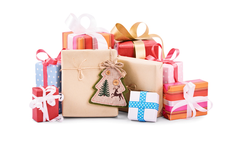 A pile of Christmas gifts isolated on white background. Standard-Bild