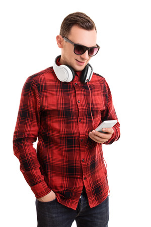 casually dressed: A portrait of a casually dressed student texting, isolated on white background.