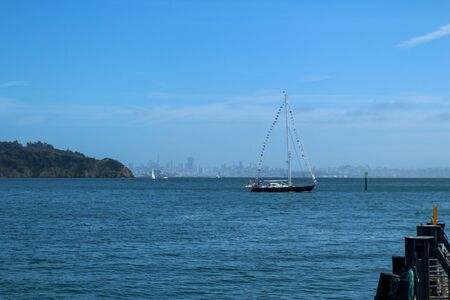 Sailboat passes the Tiburon, California Marina
