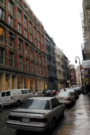 cars line this Manhattan neighborhood on a rainy fall afternoon.