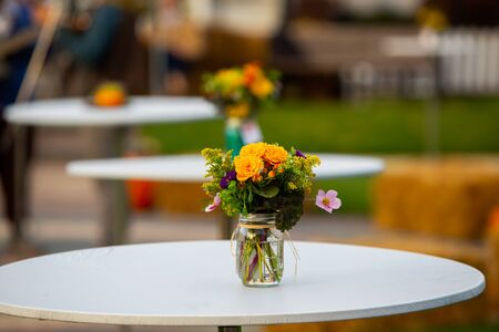 A single flower arrangement on a tabletop in downtown Farmington, MI