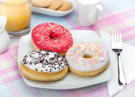 Donuts on white plate