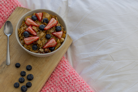strawberrys: Breakfast on the bed with cereals and strawberries