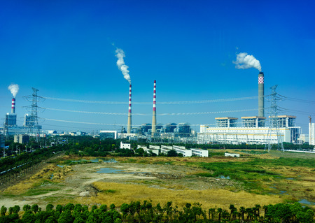 Smoking smokestack of chemical plant with blue sky Stock Photo