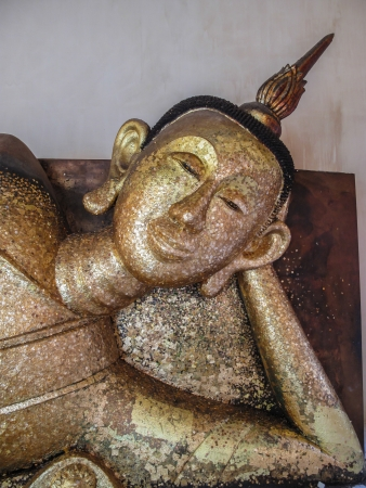 Old Buddha sleep with gold on body surface area photo
