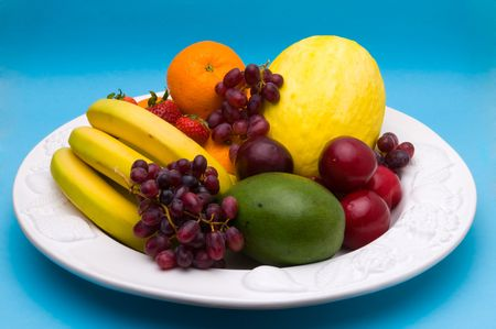 Several fresh and tasty fruits on a dish photo