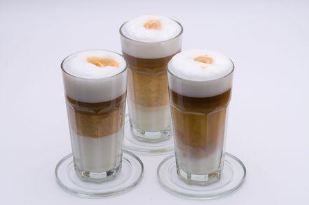 Three glases of fresh and tasty latte macchiato photo