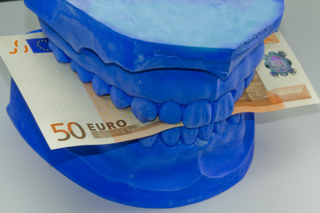 prosthesis: total prosthesis in blue with banknotes Stock Photo