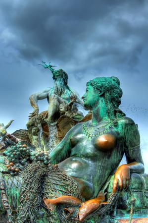 Neptune Fountain Neptune Fountain in Alexanderplatz square, Berlin, Germany - high dynamic range HDR