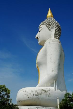 A large white Buddha statue below blue skies Stock Photo