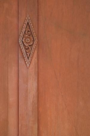 Flower sculpture on the wood door