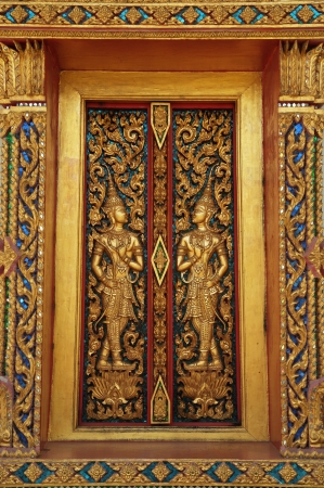 The exquisite thai patterns on the golden window of a temple