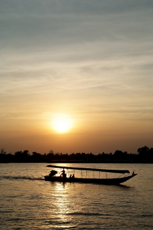 The iongtail taxi boat on sunset. Stock Photo